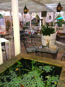 The courtyard shared by the dozen cafes and stores